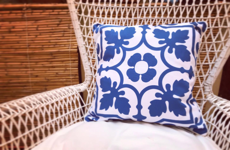 blue cushion on armchair